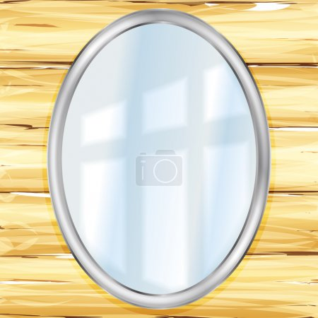 oval mirror on a wooden wall