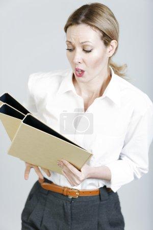 Business woman juggling folders