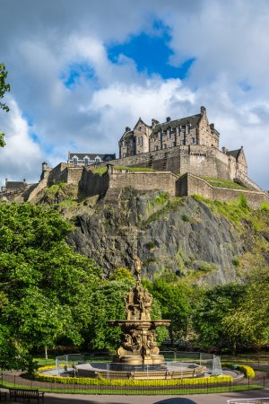 Photo for Edinburgh Castle, Scotland, from Princes Street Gardens, with the Ross Fountain in the foreground - Royalty Free Image