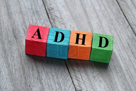 Concept of ADHD on colorful wooden cubes