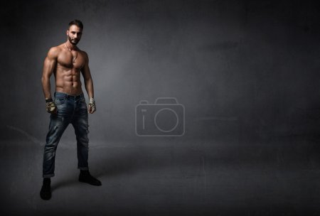 Photo for Man with muscles waiting for fight, dark background - Royalty Free Image