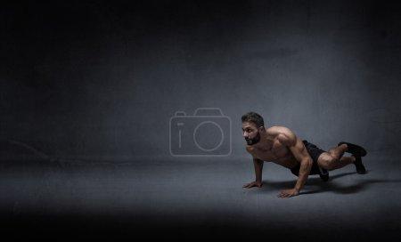 man pushing on the floor