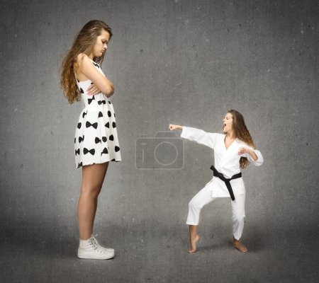 Little judo girl fighting with big casual woman