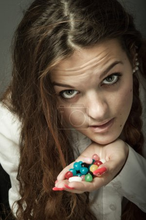 Girl with candies in hands