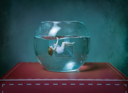 Photo for Girl dead in a fishbowl - Royalty Free Image