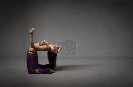 belly dancer in dark background