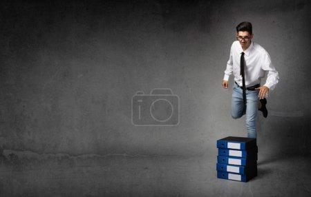 business man kicking files