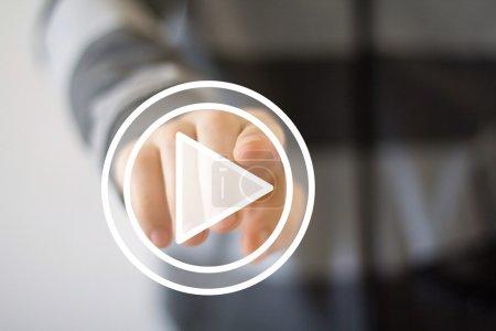 Businessman hand press play button icon