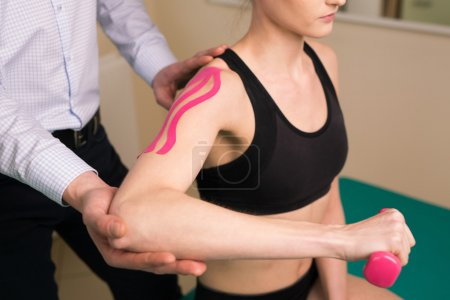 Physiotherapist doing shoulder exercise