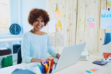 woman working in her small office