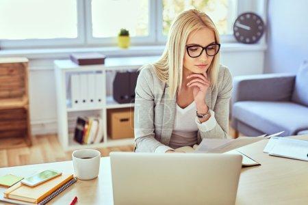 woman reading financail documents