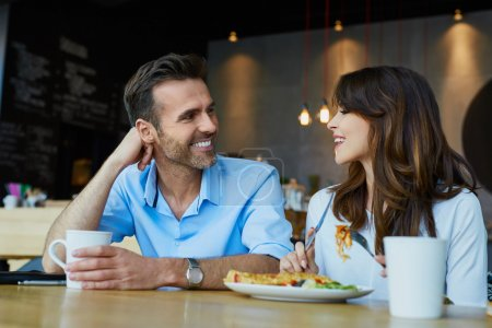 Photo for Couple in cafe talking during lunch - Royalty Free Image