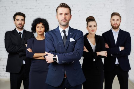Photo for Group of perky lawyers, businesspeople standing together - Royalty Free Image