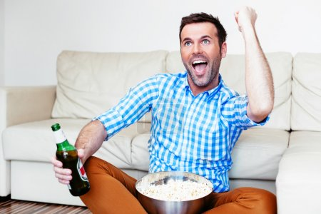 Sports fan watching game on tv