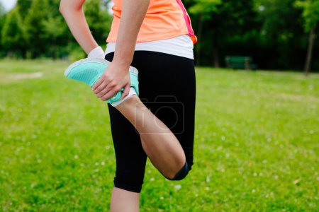 Woman warming up before run