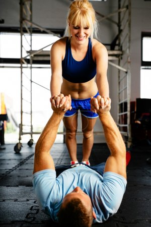 Woman doing push-ups with partner
