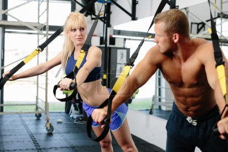 Muscular couple working out