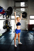 Female bodybuilder with a barbell