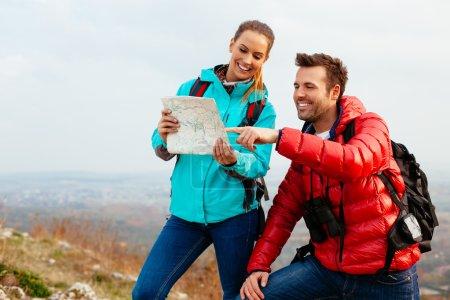 Happy couple reading map