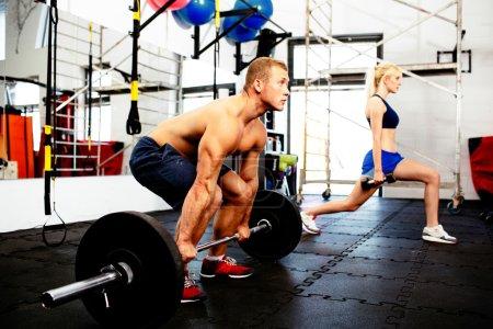 Couple training at gym