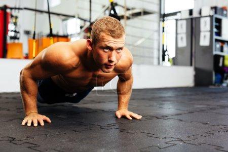 Athlete practicing suspension pushups