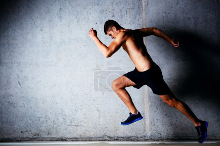 Runner against concrete wall