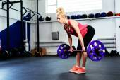 woman doing Straight Leg Deadlift exercise