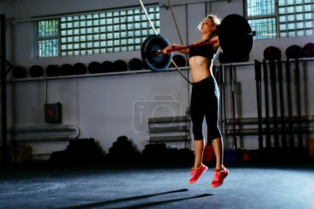 Photo for Woman training snatch at gym - Royalty Free Image