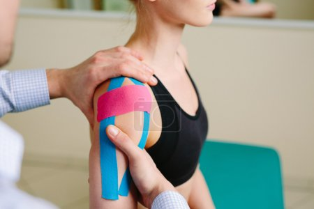 Woman having shoulder physical therapy