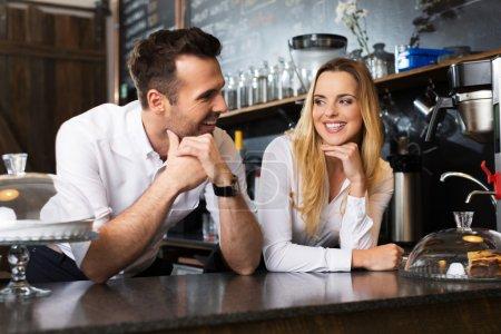 bartenders talking behing the bar