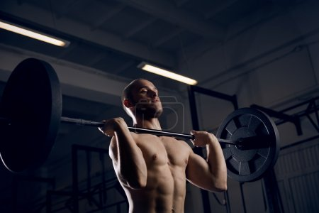 Photo for Closeup of athlete training snatch exercise with barbells - Royalty Free Image