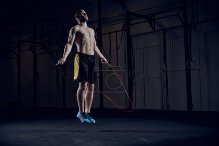 male athlete skipping rope