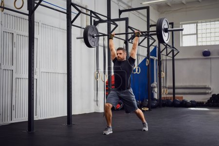 Lunges with barbells over head