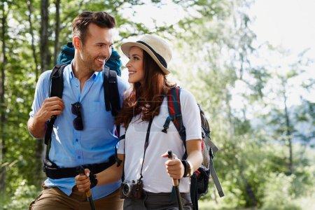Happy backpackers couple hiking