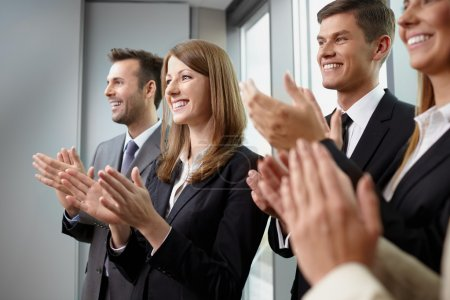 Group of business people clapping hands. Business seminar concep
