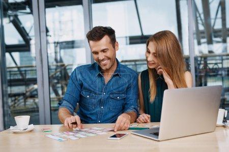 Happy web designers creating