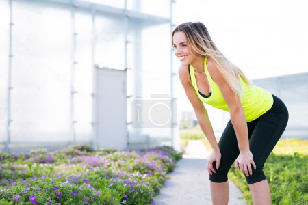 Young female athlete resting