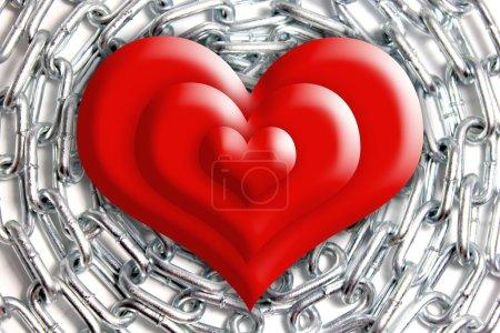 Photo pour Coeur rouge sur fond de chaîne en argent - image libre de droit
