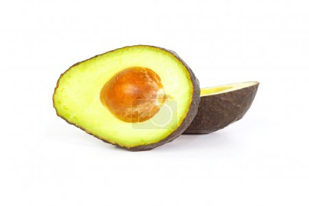 Two halves of avocados against white background