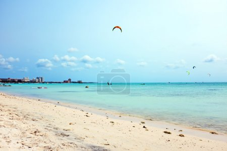 Photo for Kite surfing at Fisherman's Huts on Aruba in the Caribbean - Royalty Free Image