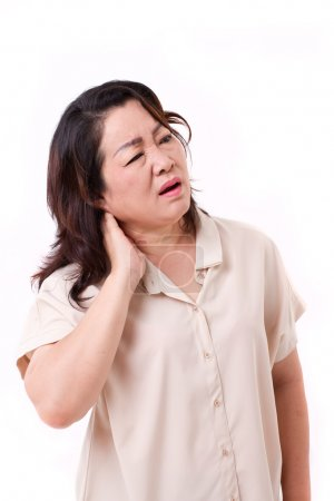 Middle aged woman suffering from neck pain...