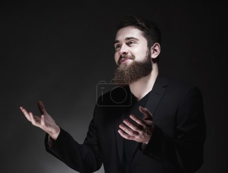 Teenage Hipster  with Beard Gesticulating