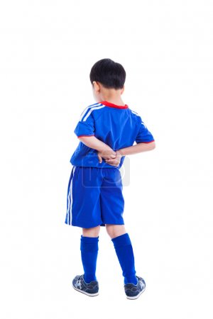 Back pain. Child rubbing the muscles of his lower back, Isolated
