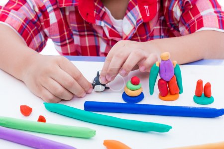 Close up child's hand moulding modeling clay. Strengthen the imagination of child.