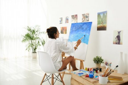 Mid adult woman painting