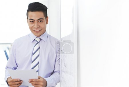 Businessman with document smiling