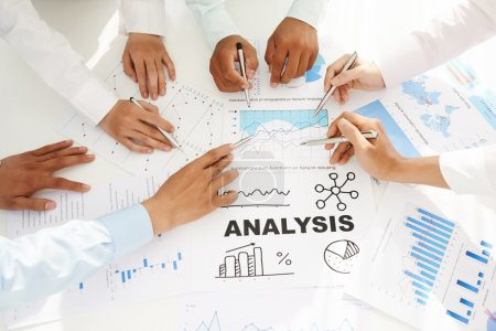 Photo for Team analyzing business activity of the company. Working with business reports - Royalty Free Image