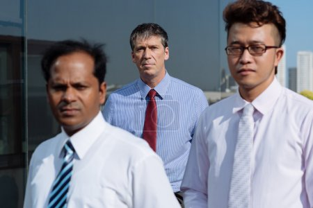 business people standing outdoors