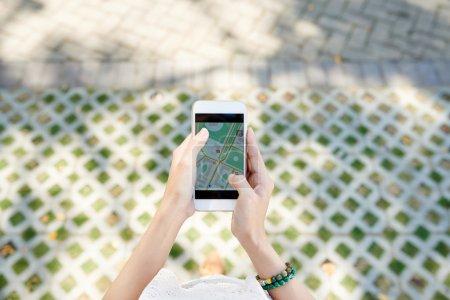 Traveller using GPS navigator