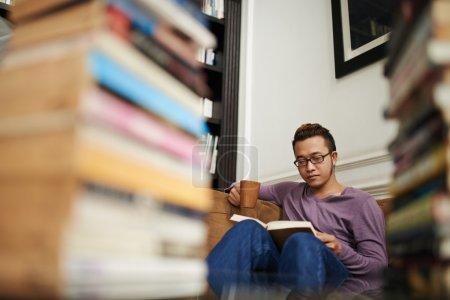 Man in glasses reading book